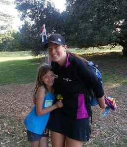Valarie Jenkins poses for a picture with a young fan at the end of her round on the 2nd day of Masters Cup action at DeLaveaga Disc Golf Course in Santa Cruz, CA. Photo by Jack Trageser.
