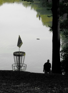 A player attempts a comeback putt on hole 18 at Winthrop Gold in Rock Hill, SC after missing his downhill birdie run. Photo by Jack Trageser.