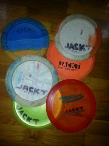 This collection of discs from the author's bag show the consistency and readability of his 'personal branding'. Look closely, and you notice that some need a fresh coat, and the rare gummy Beast on top has the brand written backwards on the bottom so it shows correctly on top. Photo by Jack Trageser.